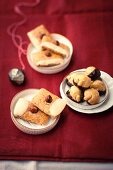Nut biscuits with icing sugar and peanut and marzipan biscuits