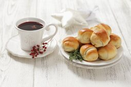 Bread rolls filled with sauerkraut and mushrooms and a cup of borscht