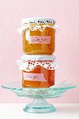 Jars of jam with doily lids