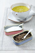 White soup bowl next to homemade salt and pepper cellars