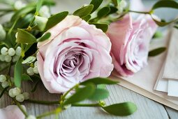 Pink roses and mistletoe
