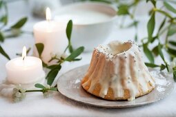 A mini Bundt Cake with icing sugar