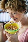A women eating muesli