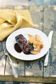 Ox roulade with red wine sauce and baked potatoes
