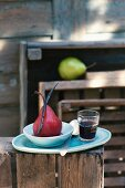 Red wine pears with a vanilla pod