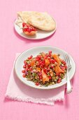 Lentil salad with pomegranate and hot smoked salmon