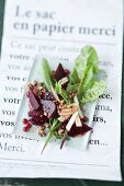 Beetroot salad with dandelions and apple