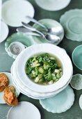 Green minestrone and pesto crostini