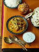 Chicken korma and side dishes (India)
