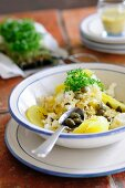Potato and sauerkraut salad with capers and cress