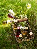 Italian herbal lemonade in a wire bottle basket on the grass