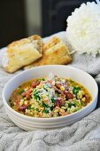 Pearl barley soup with bacon and pine nuts