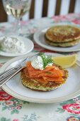 Spinach and cheese pancakes with salmon and herb cream