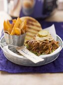 Pulled pork sandwich and potato wedges