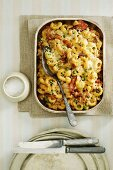 Ham and pea pasta bake topped with cheese