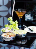 A Roquefort dip with caramelised onions and walnuts, celery and a cocktail