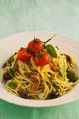 Spaghetti with anchovies, tomatoes and olives