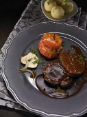 Sauerbraten made from leg of venison with baked apple, dumplings and sauce