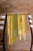 Home-made pasta hanging up to dry