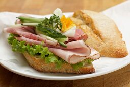 A ham, cucumber, egg and cress sandwich