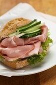 A mortadella and cucumber sandwich