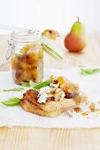 A goat's cheese and walnut sandwich with pear and orange chutney