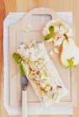 Meringue roulade with caramel cream and pears