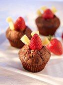 Chocolate muffins with strawberries