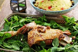 Roast shoulder of lamb with fresh mint in a roasting tin