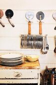 Kitchen utensils on a wall and on a vintage table