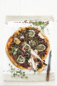 Red onion, spinach, goat's cheese and olive pizza