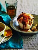 Suet pudding with an apple filling and caramel sauce