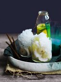 Coconut granita on lychees with pineapple and ginger syrup