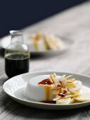 Coconut pudding with banana and coconut caramel