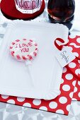 A paper plate with a name tag and a lolly