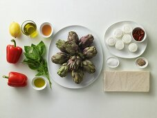 Ingredients for goat's cheese sandwiches on an artichoke salad