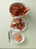 Cooked crayfish being shelled