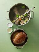 Roasted leg of lamb being added to soup