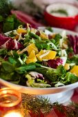 A colourful mixed leaf salad with oranges for Christmas dinner (Sweden)
