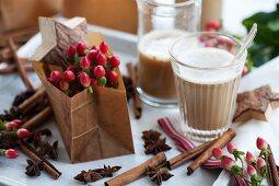 St. John's wort in a paper bag, a chai tea, cinnamon sticks and star anise