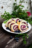Swiss roll with blueberry ice cream