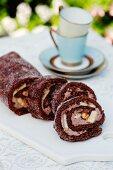 Chocolate Swiss roll with bananas and hazelnuts