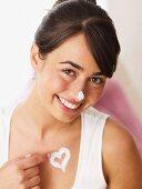 Smiling woman applying creme