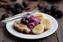 Roast pork with chestnuts, red cabbage and potato dumplings