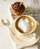A cappuccino and a chocolate cupcake