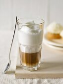 Coffee with milk foam in a glass