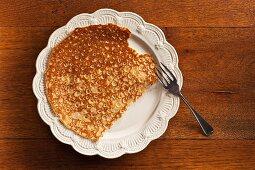 A pancake with a bite taken out