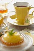Marijuana Tea in a Yellow Tea Cup; Mini Lemon Pie