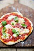 Pizza margerita with mozzarella and basil
