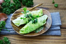 Cabbage wraps on a wooden plate